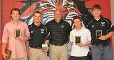 Baseball head coach Travis Henson, middle, presented the awards to the Blue Ridge Tigers at their team banquet last Thursday. Honored, left to right, were Ty Montgomery, Alex Williams, Zach Byer and Robert Westenrieder.