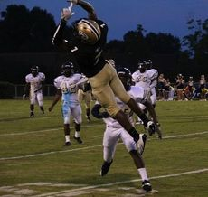 Tay Woods of Greer jumps to reack a pass that is overthrown to him.
