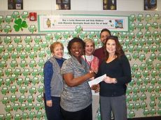 Principal Reena Watson presents a check to MDA representative Carren Evans. Back row are Beta club sponsors Frances Stephenson, Tracy Jackson and lead sponsor Chris Henslee.